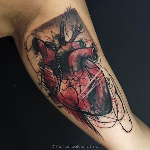 Art style colored biceps tattoo of bloody human heart