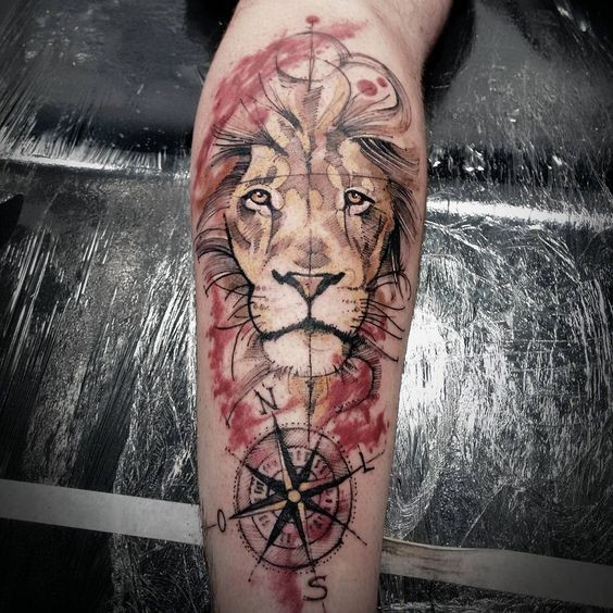 Art style colored leg tattoo of cool lion with compass