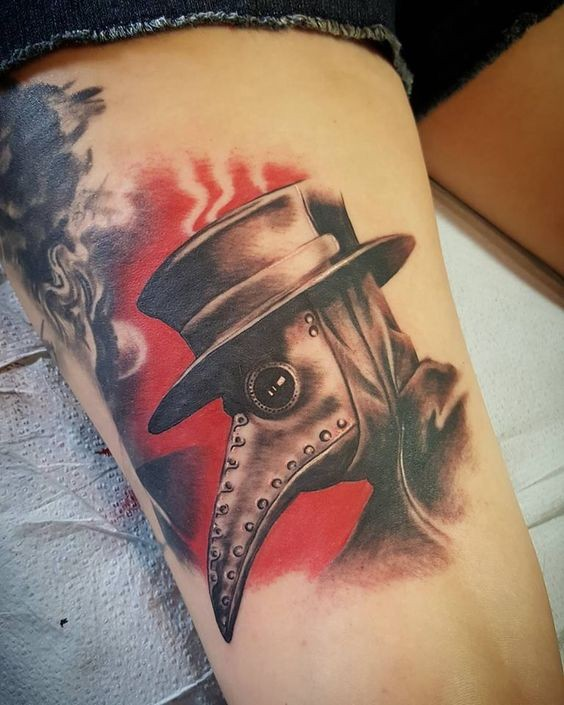 Art style colored tattoo of mystical plague doctor on leg