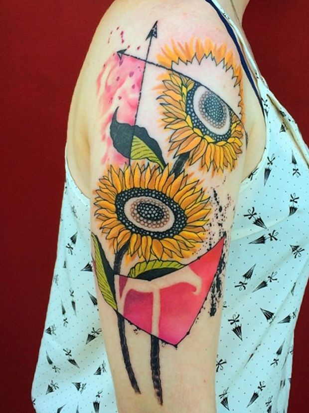 Art style colored upper arm tattoo of large flowers by Dino Nemec