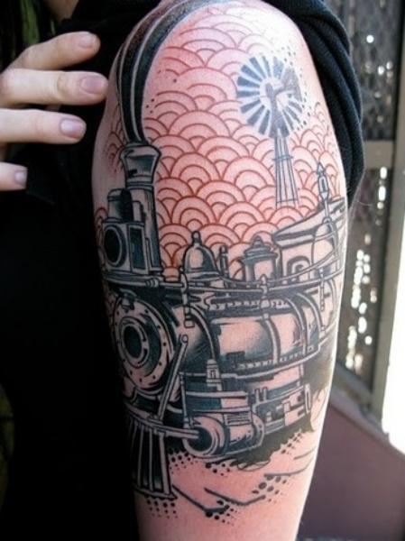 Art style colored upper arm tattoo of steam train and clouds