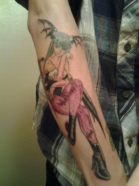 Asian cartoon style colored demonic girl tattoo on sleeve area