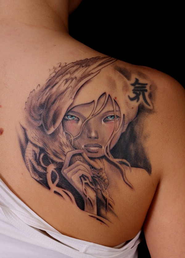 Asian cartoons like mystical woman with eagle and blue eyes tattoo on shoulder
