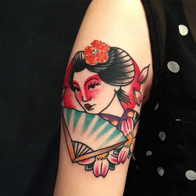 Asian colorful Geisha with bright make up and hand fen shoulder floral tattoo