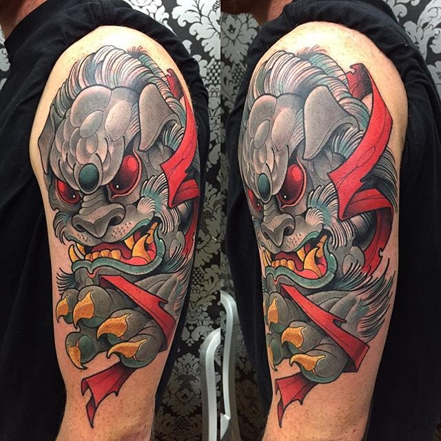 Asian style 3D like colorful shoulder tattoo of demonic tiger