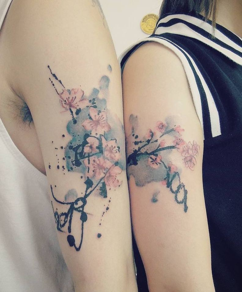 Asian style beautiful designed colorful flowers tattoo on shoulder with lettering