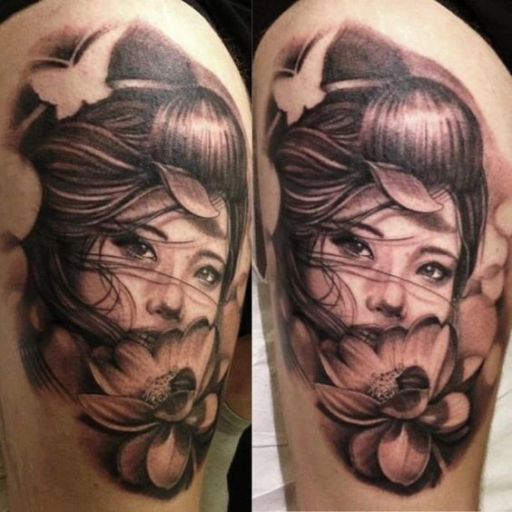 Asian style big black and white realistic woman with flowers tattoo on shoulder