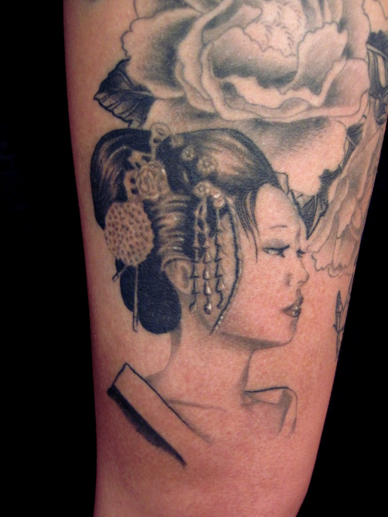 Asian style black ink arm tattoo of sad Asian woman portrait