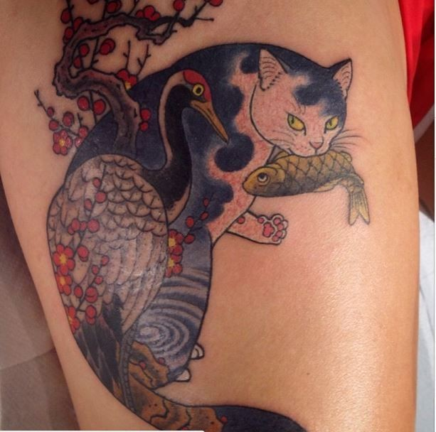 Asian style colored arm tattoo of Manmon cat with fish and bird