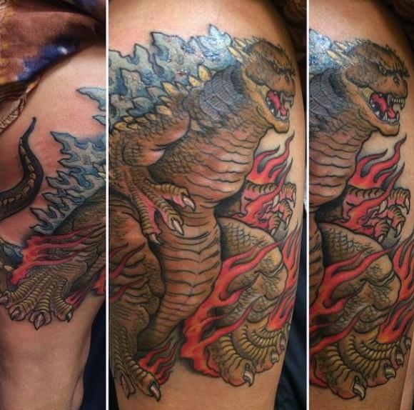 Asian style colored big burning Godzilla tattoo on thigh