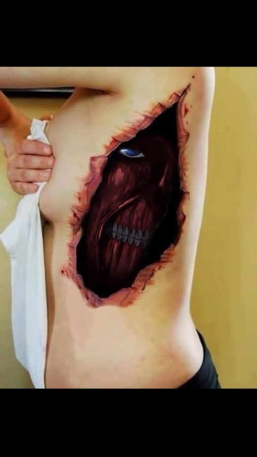 Asian style colored evil demon under the skin tattoo on side