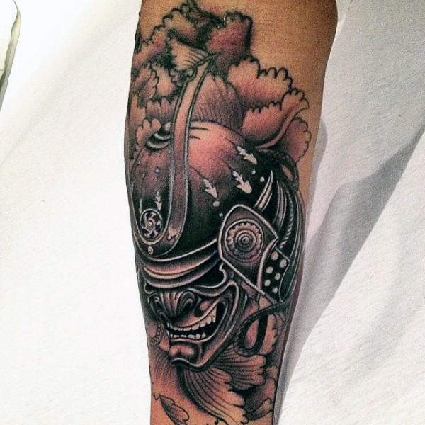 Asian style colored forearm tattoo of samurai helmet in fog