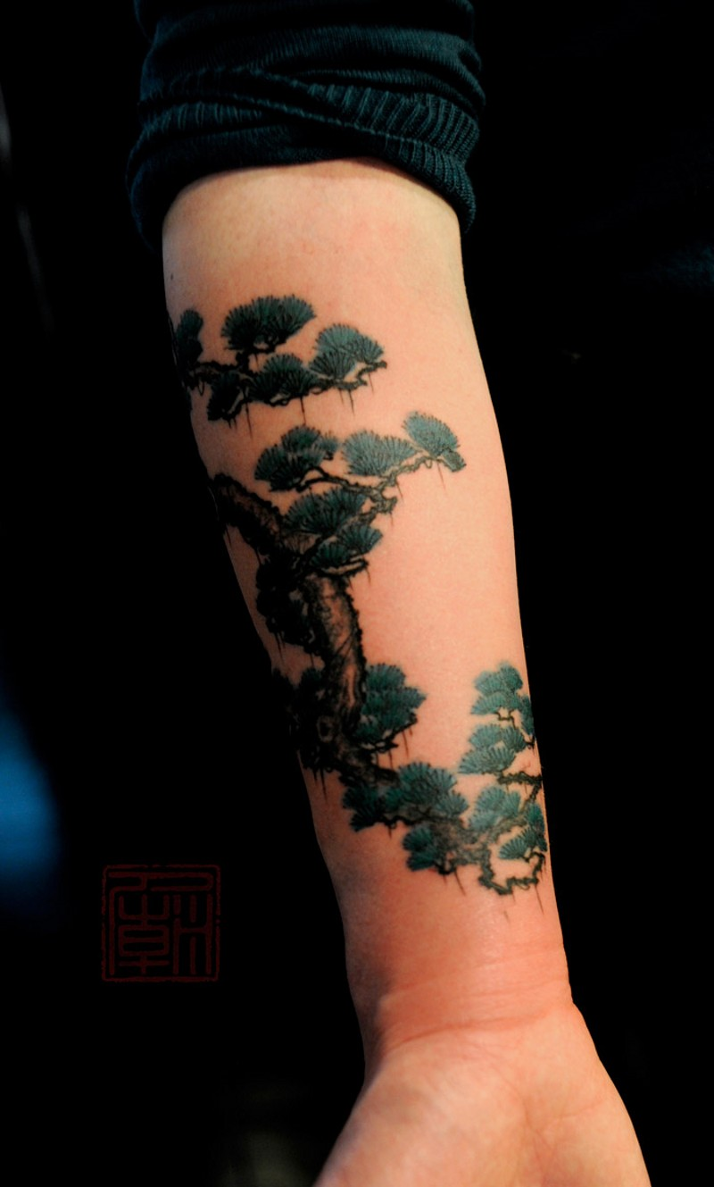 Asian style colored forearm tattoo of funny tree
