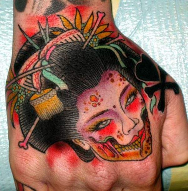 Asian style colored monster geisha face tattoo on hand
