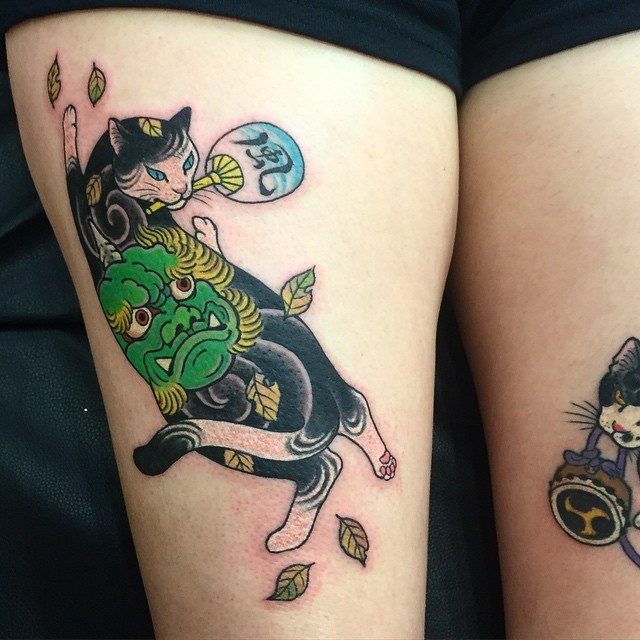 Asian style colored thigh tattoo of Manmon cat painted by horitomo