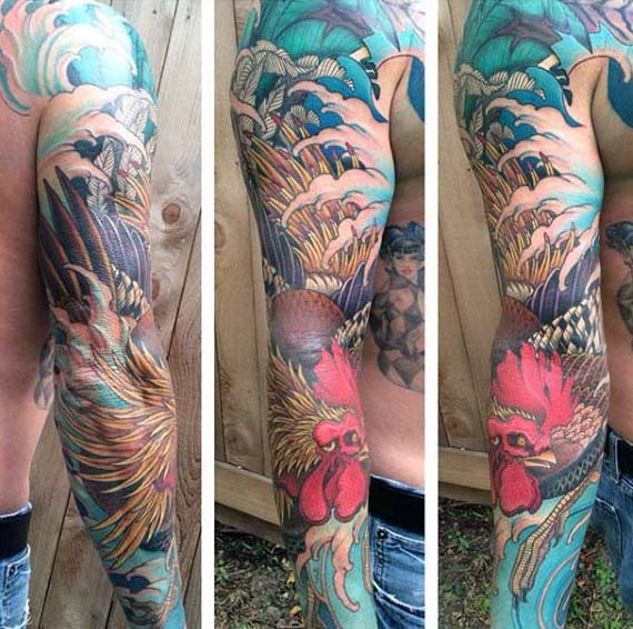 Asian style designed multicolored big cock with waves tattoo on sleeve