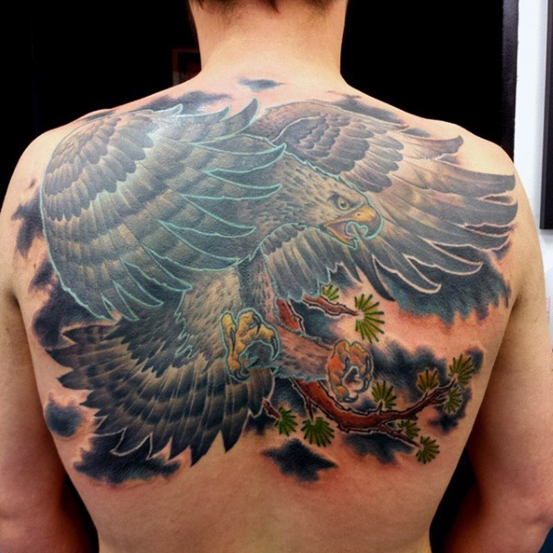 Asian style evil eagle colored tattoo on whole back with tree branch