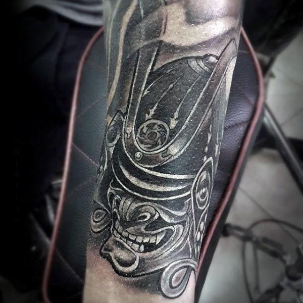 Asian style gorgeous black and white samurai helmet tattoo on arm