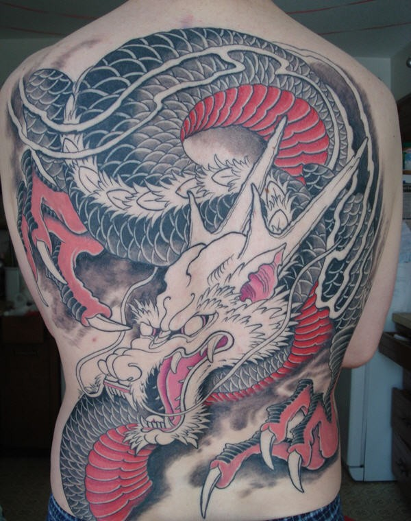 Asian style half colored big detailed dragon tattoo on whole back