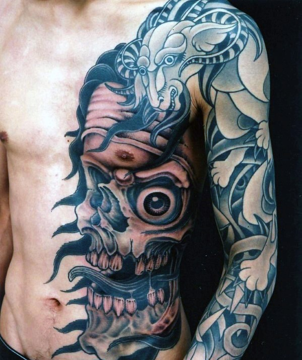 Asian style half colored monster skull with goat tattoo on sleeve and chest