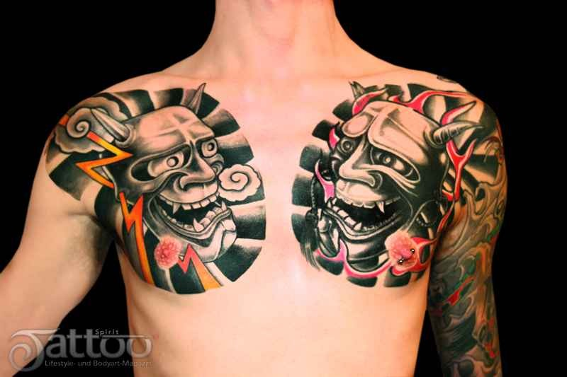 Asian style Hanya both chest colored tattoo with flames and thunders