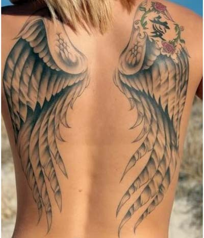 Asian style little black and white wings with symbol tattoo on whole back