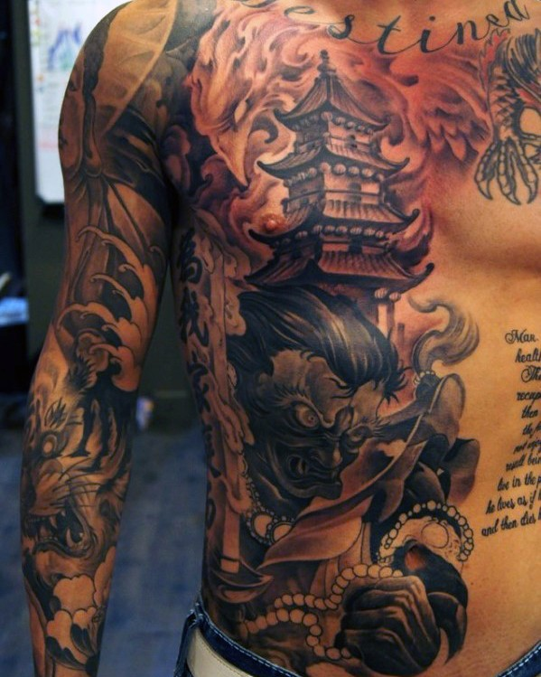 Asian style massive big house with demon and lettering tattoo on chest