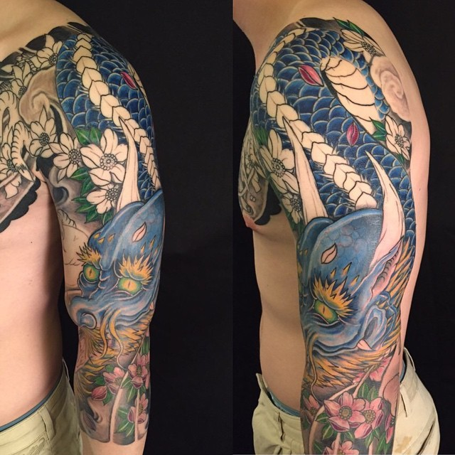 Asian style multicolored big shoulder and half sleeve tattoo of blue dragon and flowers