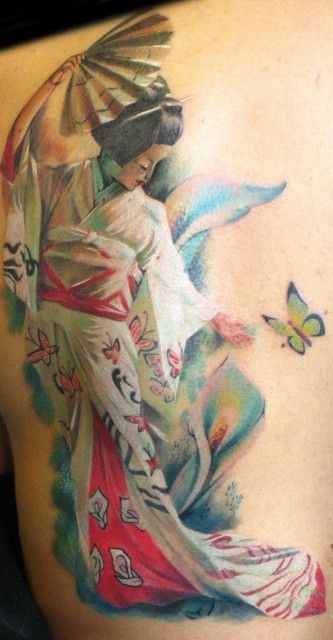 Asian style multicolored seductive geisha with flowers and butterfly tattoo on shoulder