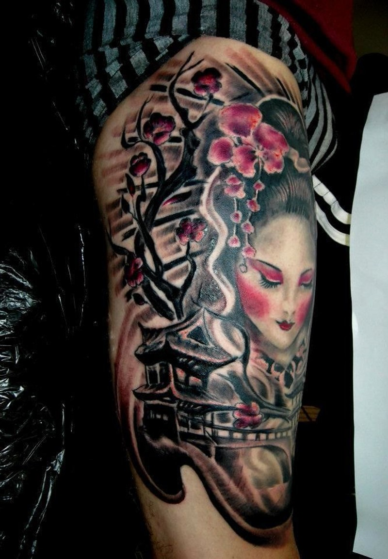 Asian style multicolored shoulder tattoo of geisha woman with antic bridge and blooming tree