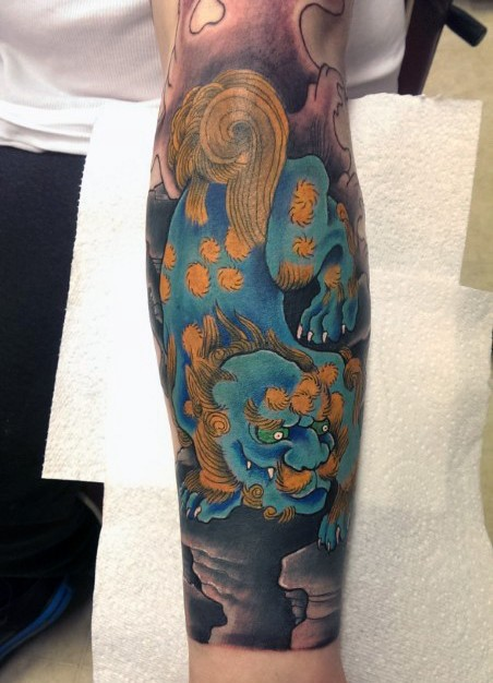 Asian style nice colored big forearm tattoo on magical tiger