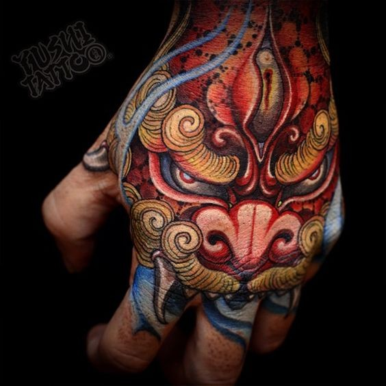Asian style nice detailed and colored on hand tattoo of fantasy tiger