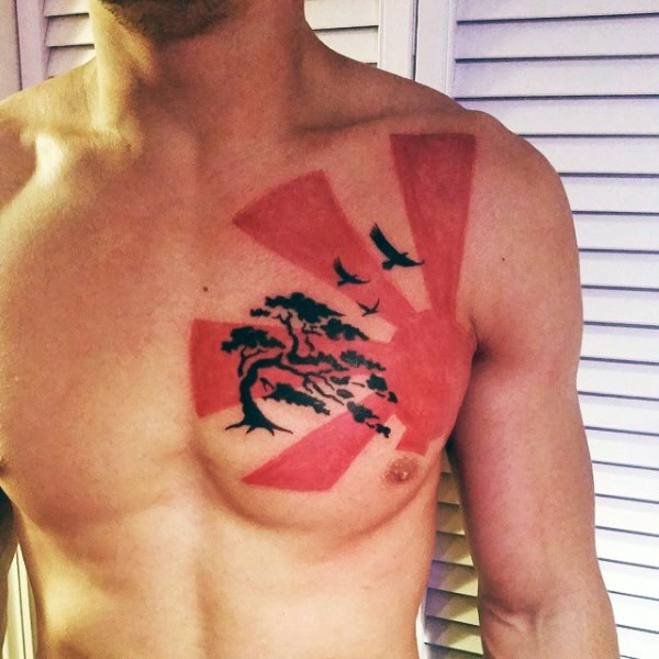 Asian style red sun with rays and flock of birds flying off the tree chest tattoo