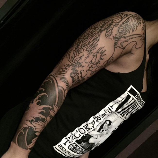 Asian style unfinished black ink sleeve tattoo of big dragon