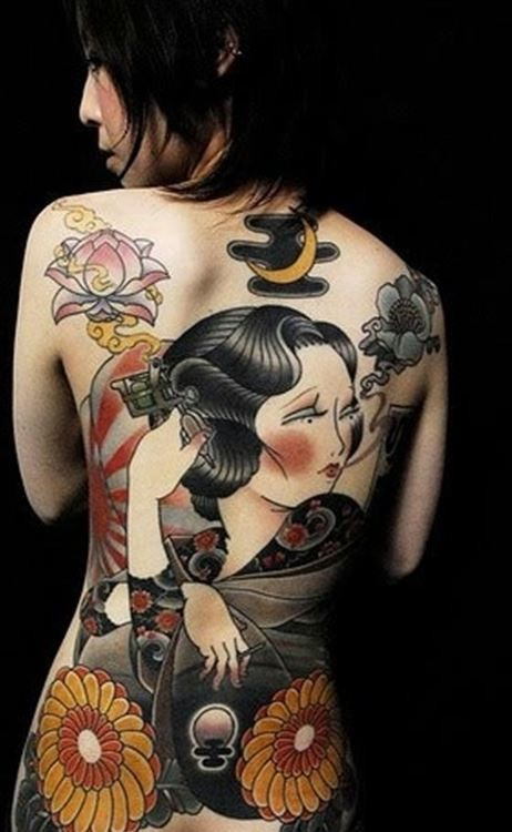 Asian themed massive simple colored geisha tattoo on whole back with flowers
