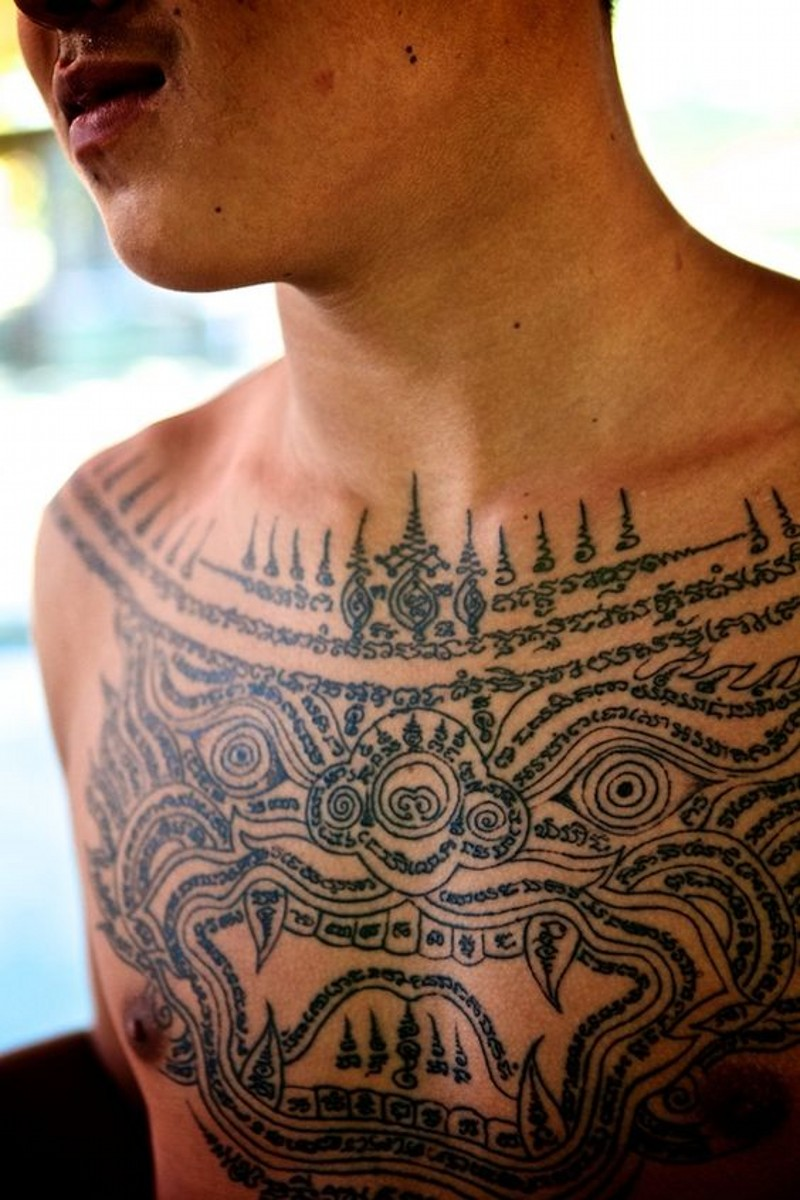Asian traditional black ink chest tattoo of antic paintings