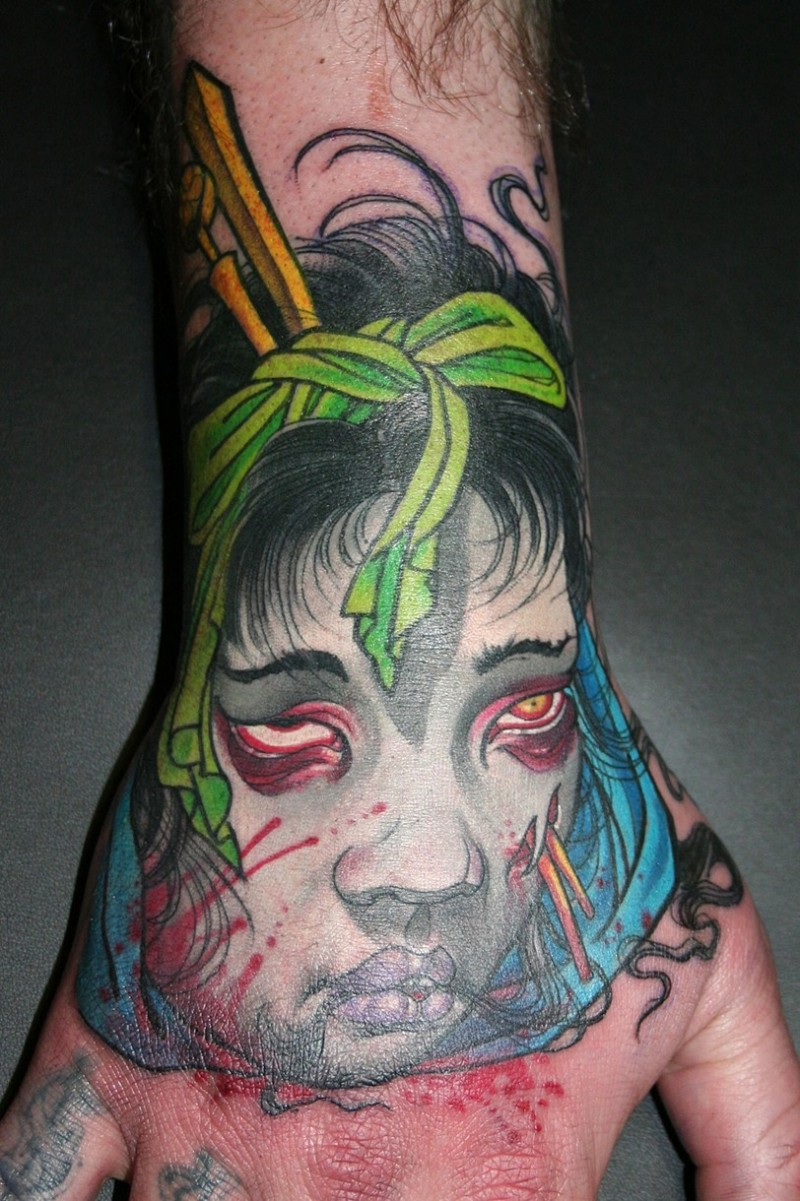 Asian traditional colorful hand tattoo of Asian zombie woman head
