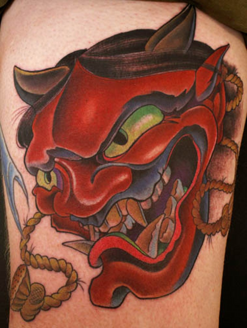 Asian traditional shoulder tattoo of red colored demonic mask