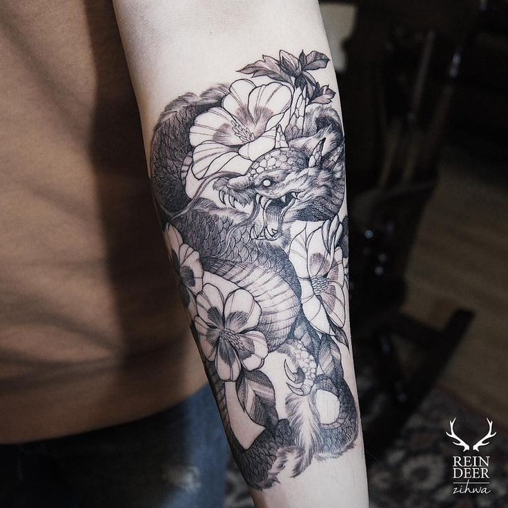 Asian traditional style black ink forearm tattoo of dragon with flowers by Zihwa