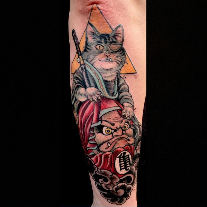Asian traditional style colored arm tattoo of samurai cat with doll and triangle