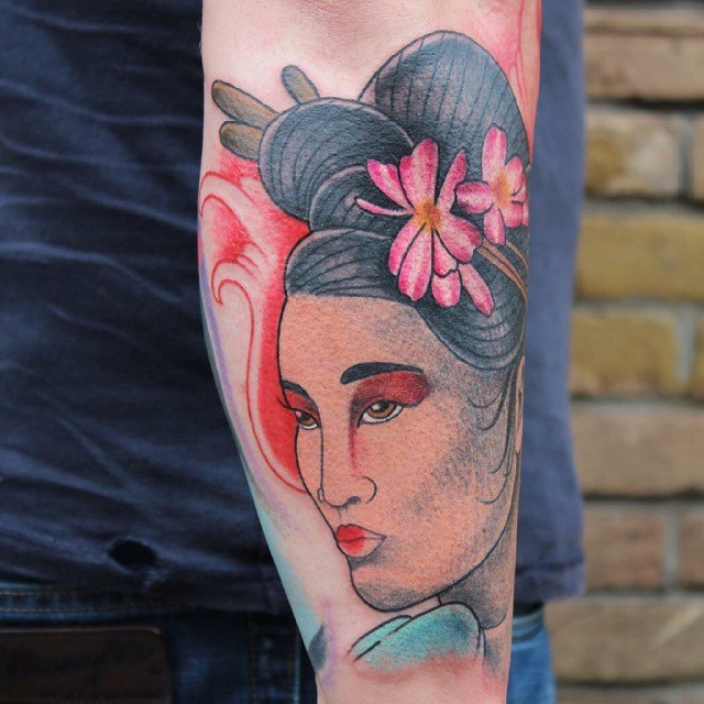 Attractive Asian Geisha with flowers in hairdo colored arm tattoo