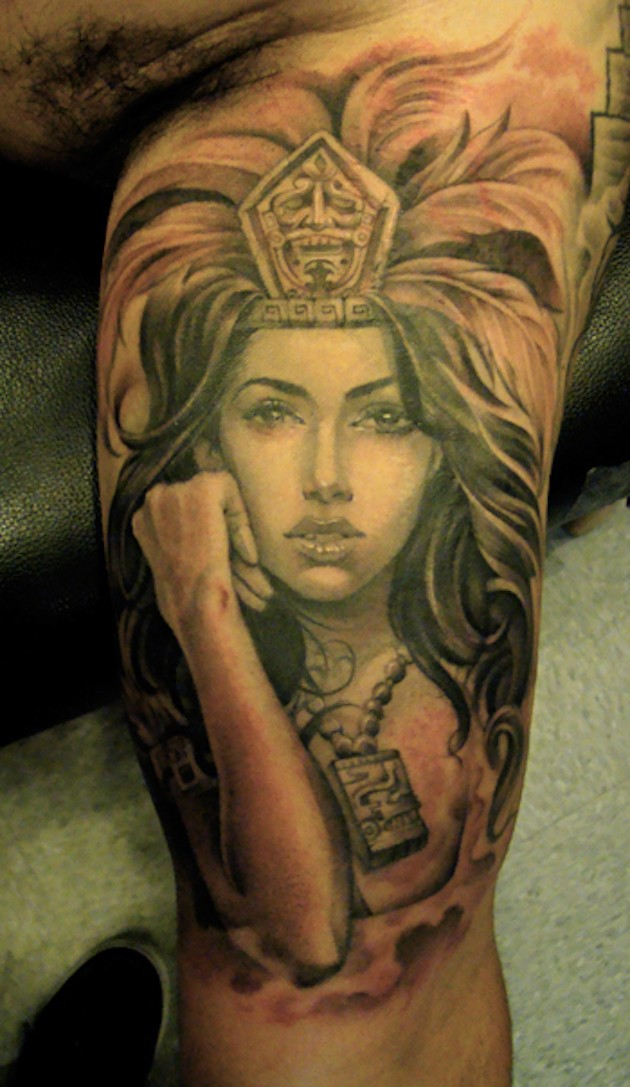 Attractive Aztec lady warrior brilliant biceps realistic tattoo