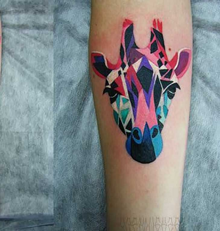 Attractive colored giraffe -head tattoo