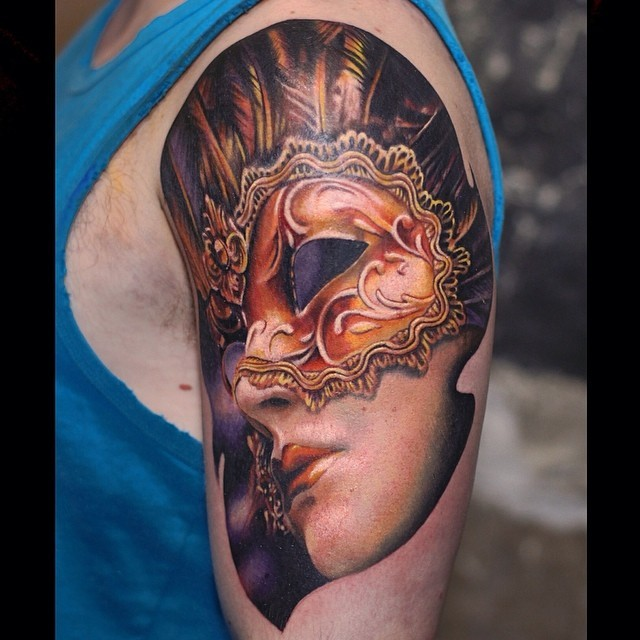 Attractive young mystical lady in ancient mask colored 3D lifelike tattoo on shoulder area