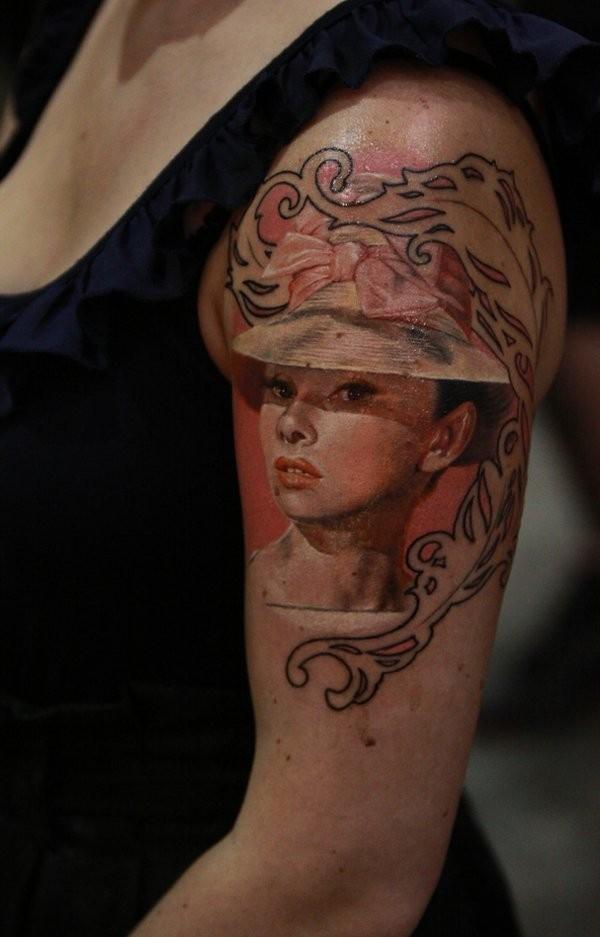 Audrey Hepburn in cute hat 3D lifelike framed portrait colored tattoo on shoulder