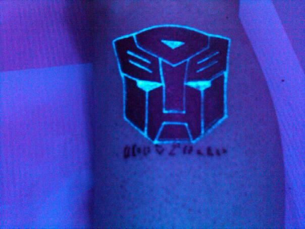 Autobot black light tattoo on the leg