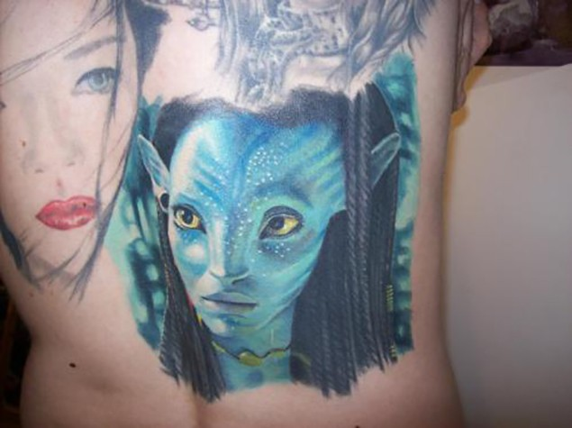 Awesome accurate painted Avatar tribal woman portrait tattoo on back
