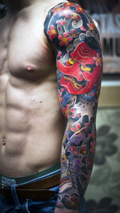 Awesome Asian style colored half sleeve tattoo of funny man with flowers