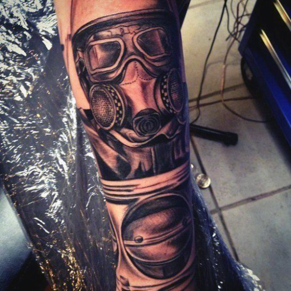 Awesome black and gray style detailed arm tattoo of man in gas mask