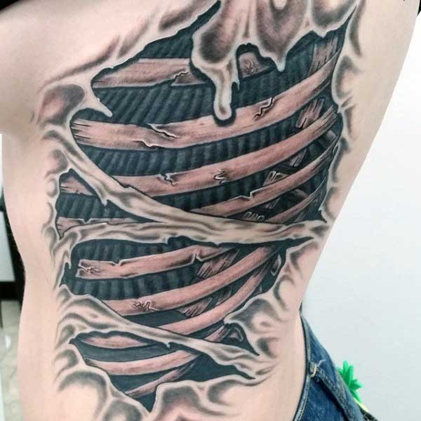 Awesome black and white broken bones tattoo on back